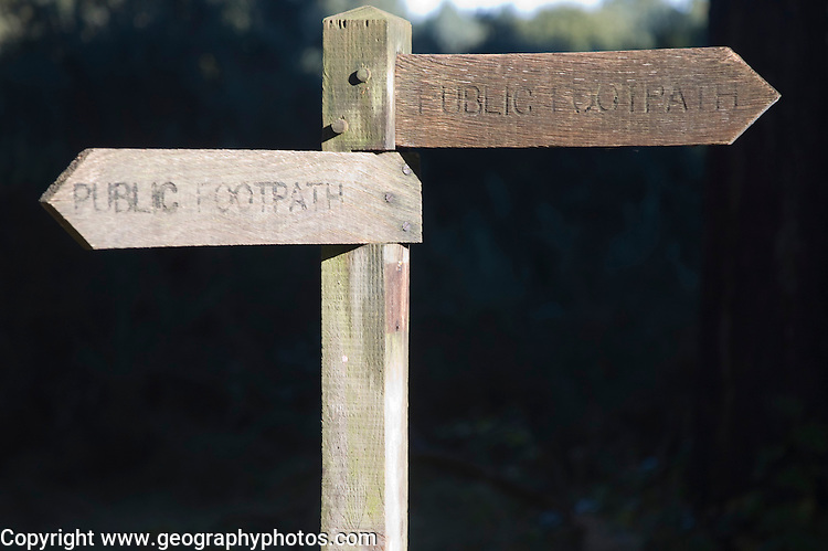 Wooden public footpath sign with two direction arrow pointers, UK