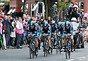 Team Sky (GBR) race past Queen's University Belfast during the first stage of the 2014 Giro d'Italia, a 21km Team Time Trial stage, May 9, 2014 in Belfast, Northern Ireland.