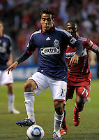 Chivas midfielder Jesus Padilla (10) controls the ball in front of Chicago midfielder Patrick Nyarko (14).  The Chicago Fire tied Chivas USA 1-1 at Toyota Park in Bridgeview, IL on May 1, 2010.
