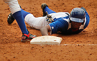 "Major League Baseball prospect Miguel Angel Mercedes slides in safely during the five inning at the final game of the ""Torneo Supremo"" at the Quiskeya National Stadium in Santo Domingo. The Tournament which aims to maximize the ability of Major League Baseball organizations to scout in the Dominican Republic. According to the MLB's office in the Dominican Republic, this year, the tournament introduced 23 new baseball prospects. July 29 2011. ViewPress/ Kena Betancur"