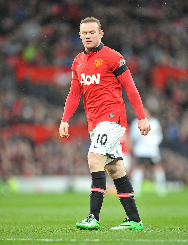 Manchester United's Wayne Rooney seems to show his frustration as his team trail 1-0 at half time<br /> <br /> Photo by Dave Howarth/CameraSport<br /> <br /> Football - Barclays Premiership - Manchester United v Fulham - Sunday 9th February 2014 - Old Trafford - Manchester<br /> <br /> &copy; CameraSport - 43 Linden Ave. Countesthorpe. Leicester. England. LE8 5PG - Tel: +44 (0) 116 277 4147 - admin@camerasport.com - www.camerasport.com