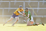 David Mc Inerney of  Clare  in action against Gearoid Hegarty of  Limerick during their NHL quarter final at the Gaelic Grounds. Photograph by John Kelly.