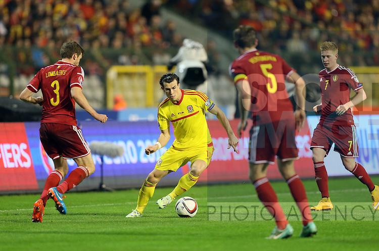 Belgium's Nicolas Lombaerts tussles with Wales' Gareth Bale<br /> <br /> - European Qualifier - Belgium vs Wales- Heysel Stadium - Brussels - Belgium - 16th November 2014  - Picture David Klein/Sportimage
