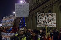Protesters hold banners during a demonstration against government corruption in Budapest, Hungary on December 16, 2014. ATTILA VOLGYI