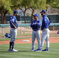 Pitcher David Price ((left) talks with manager Dave Roberts (center) and pitching coach Mark Prior (right) after his first live batting practice session at the Los Angeles Dodgers spring training facility at Camelback Ranch on February 21, 2020 in Glendale, Arizona (Bill Mitchell)