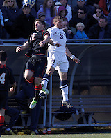 Northeastern University forward Don Anding (12) and University of Connecticut defender Max Wasserman (22) battle for head ball. .NCAA Tournament. University of Connecticut (white) defeated Northeastern University (black), 1-0, at Morrone Stadium at University of Connecticut on November 18, 2012.