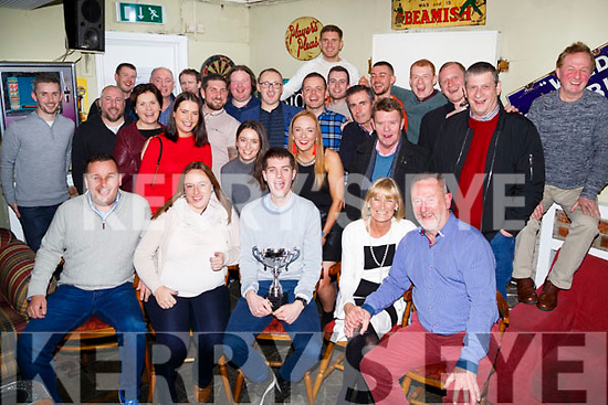 The O'Brien Family Tim,Mary, Liam and Gillian Loughnane who presented Gary Coughlan with the Tim O';Brien Memorial Soccer Cup in Linane's Bar,Roick Street,Tralee on Thursday evening with fellow players who took part in the soccer memorial looking on.