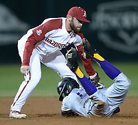 NWA Democrat-Gazette/ANDY SHUPE<br /> Arkansas second baseman Trevor Ezell applies the tag on Western Illinois center fielder Diego Munoz Tuesday, March 12, 2019, during the fifth inning at Baum-Walker Stadium in Fayetteville. Visit nwadg.com/photos to see more photographs from the game.