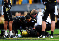 04 October 2008: Colorado head coach Dan Hawkins and members of the Colorado medical staff tend to injured player Ryan Walters during a game against Texas. The Texas Longhorns defeated the Colorado Buffaloes 38-14 at Folsom Field in Boulder, Colorado. For Editorial Use Only