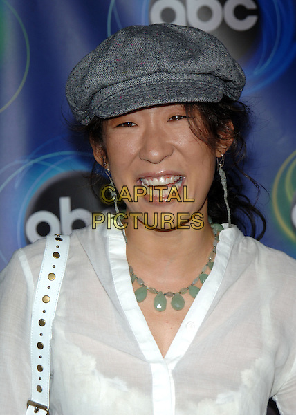 SANDRA OH.ABC 2005 Summer Press Tour Party held at the Abby, West Hollywood, California..July 27th, 2005.Photo Credit: Jacqui Wong/Admedia.headshot portrait hat dangling earrings necklace.www.capitalpictures.com.sales@capitalpictures.com.© Capital Pictures.