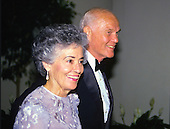 United States Senator John H. Glenn, Jr. (Democrat of Ohio) and his wife, Annie, arrive at the State Dinner in honor of Prime Minister Benazir Bhutto of Pakistan on June 6, 1989..Credit: Ron Sachs / CNP