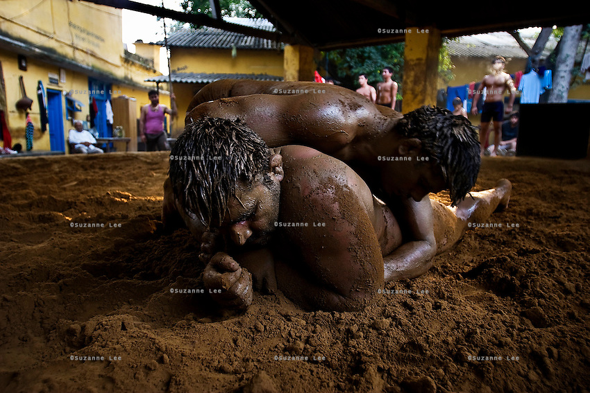 20080826, Delhi, India, Mud Wrestling - Shri Hanuman Akhara (mud wrestling school) in Old Delhi. Home to over 60 wrestlers and akhara to over 60 more. This school has produced many medal winning wrestlers, the latest being the 3rd runner-up in the 2008 Olympic Games, Rajiv Tomar Pehalwan.