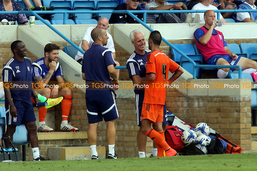 Ipswich Manager, Mick McCarthy, shares a joke with trialist, Kevin Bru, as he is replaced during the second half - Gillingham vs Ipswich Town - Pre-Season Friendly Football Match at Priestfield Stadium, Gillingham, Kent - 26/07/14 - MANDATORY CREDIT: Paul Dennis/TGSPHOTO - Self billing applies where appropriate - contact@tgsphoto.co.uk - NO UNPAID USE