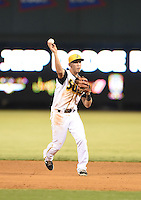Jacksonville Suns second baseman Austin Barnes (16) throws to first for the final out of game three of the Southern League Championship Series against the Chattanooga Lookouts on September 12, 2014 at Bragan Field in Jacksonville, Florida.  Jacksonville defeated Chattanooga 6-1 to sweep three games to none.  (Mike Janes/Four Seam Images)
