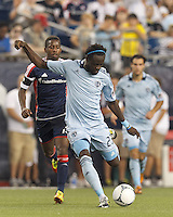 Sporting Kansas City midfielder Kei Kamara (23) takes a shot. In a Major League Soccer (MLS) match, Sporting Kansas City defeated the New England Revolution, 1-0, at Gillette Stadium on August 4, 2012.