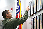 Nevada National Guard Col. Caesar Garduno checks out the newly unveiled tribute wall with the names of about 2,700 Nevada National Guard Soldiers and Airmen deployed into combat zones since Sept. 11, 2001, following a ceremony at the Office of the Adjutant General in Carson City, Nev., on Friday, April 17, 2015. <br />