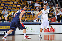25 February 2012:  FIU guard Phil Taylor (11) handles the ball while being defended by South Alabama guard Trey Anderson (1) in the second half as the FIU Golden Panthers defeated the University of South Alabama Jaguars, 81-74, at the U.S. Century Bank Arena in Miami, Florida.