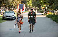 Izzy Hernandez '18 and her father Noe Hernandez P'18 walk to Kemp Stadium. Occidental College celebrates Homecoming and Family Weekend on Saturday, Oct. 14, 2017 at Oswald's Homecoming Party in the Academic Quad, featuring games, activity booths, a pub and food.<br /> (Photo by Marc Campos, Occidental College Photographer)