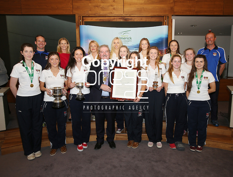 With compliments.  A Civic Reception on Wednesday evening last in the Council Chamber, Dooradoyle to honour the following  : The Irish Red Cross Limerick Area celebrating seventy five years of volunteer service to the people of Limerick City and County. The Under 20's Team 2014/2015 The Limerick Lakers Basketball Club in recognition of the Club winning The Cork County Cup, The Cork League Cup and The Cork League Top Four Playoff Cup and The Crescent College Comprehensive Senior Girls Hockey Squad in recognition of the Squad winning The All Ireland Kate Russell Hockey Tournament 2015.  Photographed at the event were the Mayor of Limerick Cllr Kevin Sheahan presenting the Parchment to the Crescent College senior hockey tteam including principal Karin Fleming, Brian Collins, manager and Sean O'Callaghan, coach.       Photograph Liam Burke/Press 22