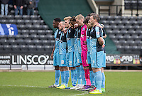 The tWycombe team stand for a minutes silence in memory of the terrorist attacks around the world during the Sky Bet League 2 match between Notts County and Wycombe Wanderers at Meadow Lane, Nottingham, England on 28 March 2016. Photo by Andy Rowland.