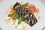 Cornelia Street Cafe, Chef Daniel Latham. Black Sesame Crusted Salmon with a Ginger Wasabi Viniagrette on a warm Carrot & Snow Pea Salad.Greenwich Village, New York, N.Y.