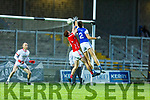 Kerins O'Rahillys Gavin O'Brien gets a touch to the ball as he out jumps East Kerrys Shane Courtney and keeper James Devane keep an eye on the ball in the County Football Championship 3rd round game on Saturday.