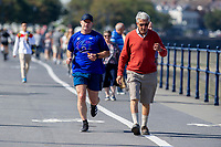 Pictured: A runner during the sunny weather at Mumbles, near Swansea, Wales, UK. Thursday 19 September 2019