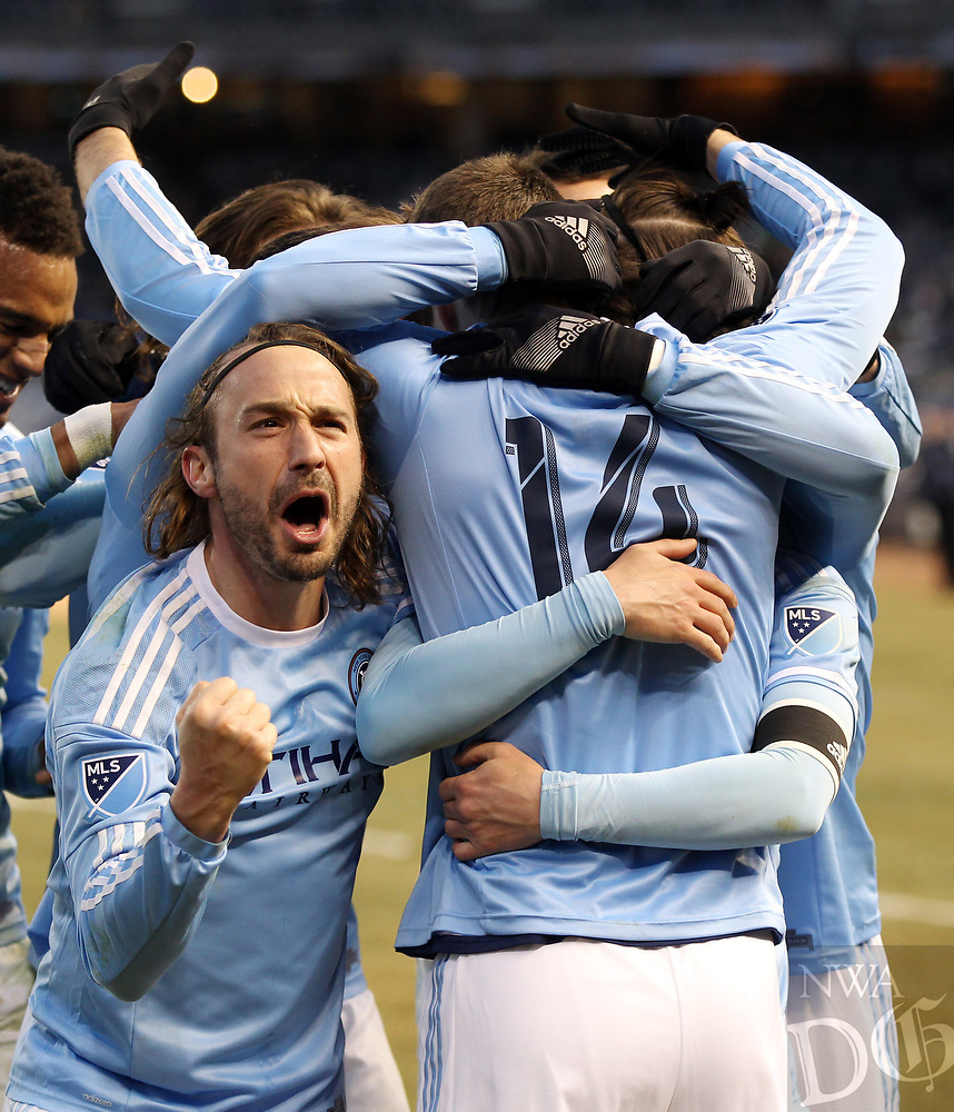 New York City FC's Ned Grabavoy, front left, celebrates with teammate Patrick Mullins (14) after Mullins scored the team's second goal against the New England Revolution in an MLS soccer game in New York on Sunday, March 15, 2015. NYC FC won the game 2-0. (AP Photo/Peter Morgan)