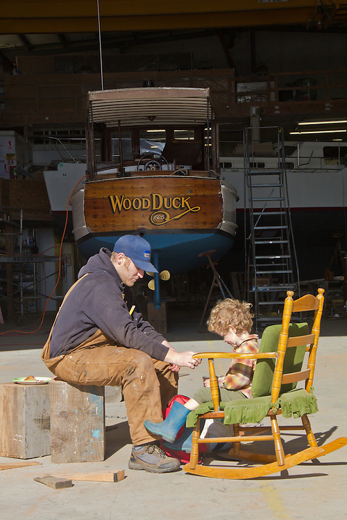 Port Townsend, shipwright and son lunch in the yard, Port Townsend Shipwrights Cooperative, yacht, Wood Duck, Port of Port Townsend, Boat Haven Marina, Puget Sound, Washington State, Jefferson County, Brad Seamans,