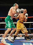 GLASGOW, SCOTLAND - MARCH 10: Gary O'Sullivan (green shorts) exchanges blows with Paul Morby (gold shorts) during a Welterweight contest on the Ricky Burns undercard at the Braehead Arena on March 10, 2012 in Glasgow, Scotland. (Photo by Rob Casey/Getty Images)