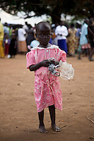 """Portait of child in Nyori refugee camp in Congo. The LRA has been attacking villages in Congo since late 2008 and kidnapping children as young as 5 years old. the boys serve as porters or soldiers in training and the girls  are given to LRA soldiers as """"wives."""""""