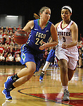 VERMILLION, SD, APRIL 2:  Taylor Gradinjan #24 from Florida Gulf Coast drives against Jasmine Trimboli #5 from the University of South Dakota during the WNIT Championship game Saturday afternoon at the Dakota Dome in Vermillion, S.D. (Photo by Dave Eggen/Inertia)
