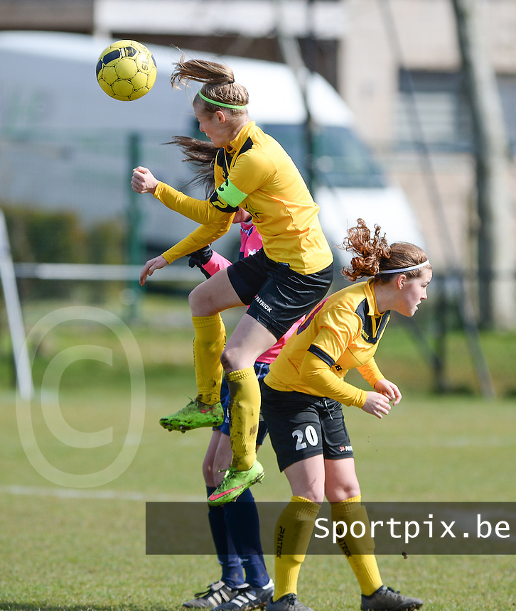 20160328 - Zwevezele , BELGIUM : duel pictured with Zwevezele's Celine Vandekerckhove (right) and Zwevezele's Eva Deparck (left)  during the soccer match between the women teams of Voorwaarts Zwevezele and FC Turnhout  , on the 20th matchday of the Belgian Third division for Women on Saturday 28 th March 2016 in Zwevezele .  PHOTO SPORTPIX.BE DAVID CATRY