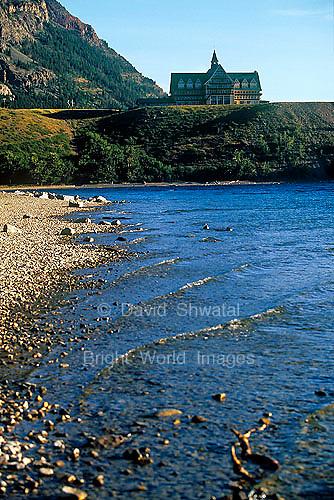 Prince of Wales Hotel overlooks Upper Waterton Lake and pebble beach Waterton Lakes National Park Alberta Canada
