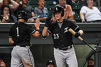 Center fielder Alex Call (1) of the Kannapolis Intimidators, left, is congratulated by Gavin Sheets (23) after scoring a run in Game 3 of the South Atlantic League Championship series against the Greenville Drive on Thursday, September 14, 2017, at Fluor Field at the West End in Greenville, South Carolina. Kannapolis won, 5-4. Greenville leads the series 2-1. (Tom Priddy/Four Seam Images)