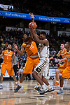 Doral Moore (4) of the Wake Forest Demon Deacons fights for a rebound with Derrick Walker (15) of the Tennessee Volunteers during first half action at the LJVM Coliseum on December 23, 2017 in Winston-Salem, North Carolina.  The Volunteers defeated the Demon Deacons 79-60.  (Brian Westerholt/Sports On Film)
