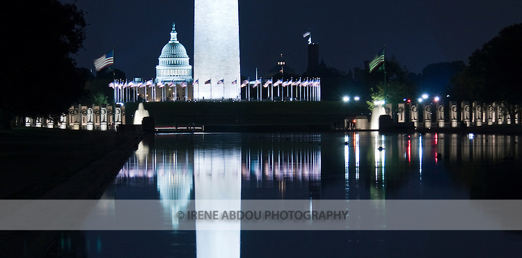 The U.S. Capitol and Washington Monument are reflected in the Reflecting Pool at night.