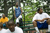 12 June 2006 - New York City, NY - Competitors Christophe Bogart (CL), 20, and others watch a game during the tryouts for the Rucker street basketball tournament, at Rucker Park in Harlem, New York City, USA, Sunday June 12 2005. Photo Credit: David Brabyn