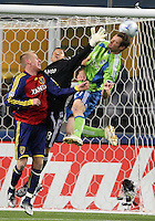 Real Salt Lake's Nat Borchers, left, and goalie, Nick Rimando, block a corner kick headed by Seattle Sounders' Nate Jaqua, right, in the first half of a MLS soccer match Saturday, March 28, 2009, at Qwest Field in Seattle. Seattle Sounders defeated Real Salt Lake 2-0. (AP Photo/Kevin P. Casey)