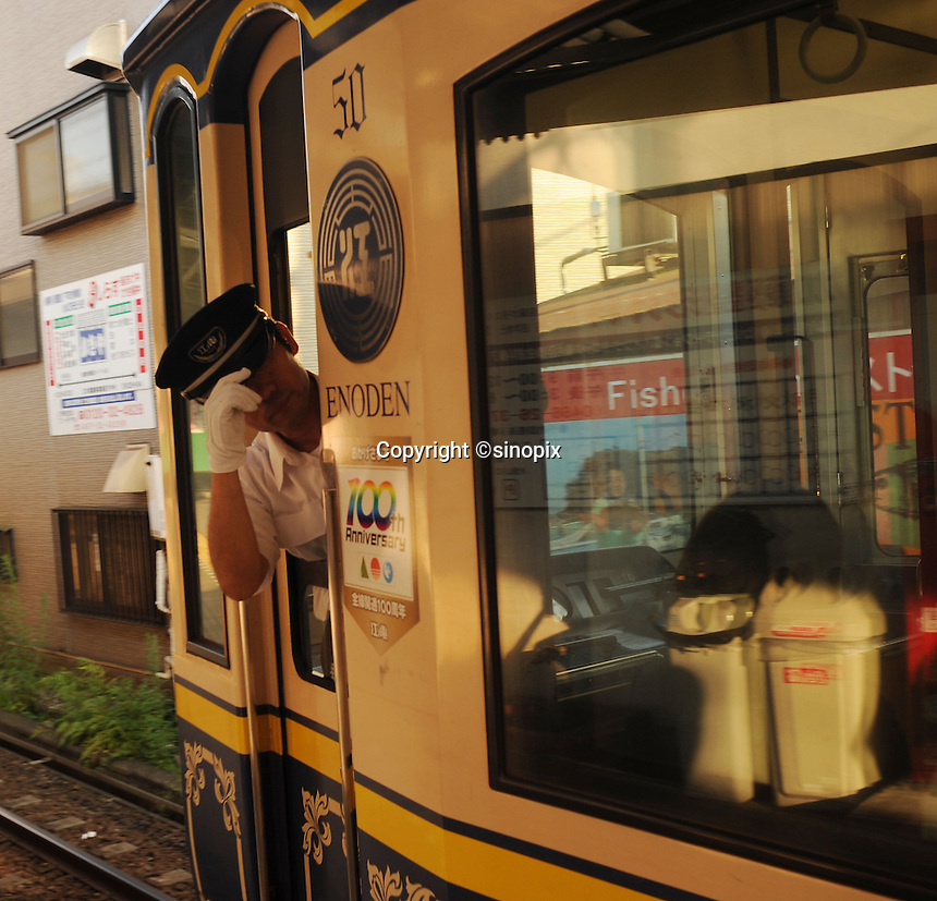 The Enoden streetcar-train line that runs from Fujisawa to Kamakora passing through Enoshima. Enoshima a small island next to a small sea-side area in Japan west of Toky and Yokohama. <br /> <br /> photo by Richard Jones/Sinopix