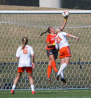 Mary Morgan (21) of Virginia has the ball tipped away from her by Kailen Sheridan (1) of Clemson at Klockner Stadium in Charlottesville, VA.  Virginia defeated Clemson, 3-0.