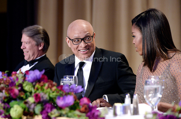 Comedian Larry Wilmore speaks with First Lady Michelle Obama during the White House Correspondents' Association annual dinner on April 30, 2016 at the Washington Hilton hotel in Washington.This is President Obama's eighth and final White House Correspondents' Association dinner.<br /> Credit: Olivier Douliery / Pool via CNP/MediaPunch