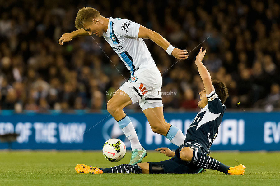 Mark Milligan of the Victory is fouled in the semi final match between Melbourne Victory and Melbourne City in the Australian Hyundai A-League 2015 season at Etihad Stadium, Melbourne, Australia.<br />