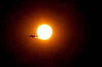 Aug 7, 2017; Phoenix, Arizona, USA;   Southwest Airlines flight #2078 heading to Milwaukee is silhouetted as it flies through the sun after taking off from Phoenix Sky Harbor International Airport. Mandatory Credit: Mark J. Rebilas
