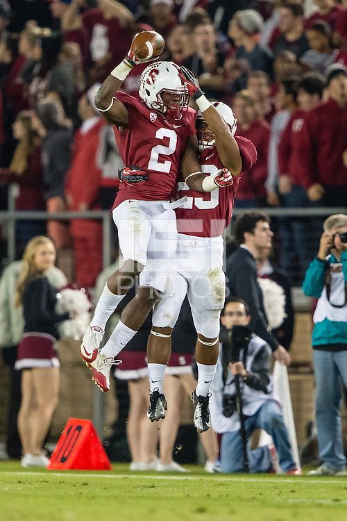 STANFORD, CA - NOVEMBER 30, 2013: Wayne Lyons and Jackson Cummings celebrate Lyon's interception during Stanford's game against Notre Dame. The Cardinal defeated the Fighting Irish 27-20.