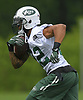 Matt Forté #22, New York Jets running back, heads upfield after taking a handoff in the first day of offseason training activity at the Atlantic Health Jets Training Center in Florham Park, NJ on Tuesday, May 23, 2017.