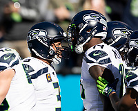 CHARLOTTE, NC - DECEMBER 15: Russell Wilson #3 and D.K. Metcalf #14 of the Seattle Seahawks celebrate after a touchdown pass during a game between Seattle Seahawks and Carolina Panthers at Bank of America Stadium on December 15, 2019 in Charlotte, North Carolina.