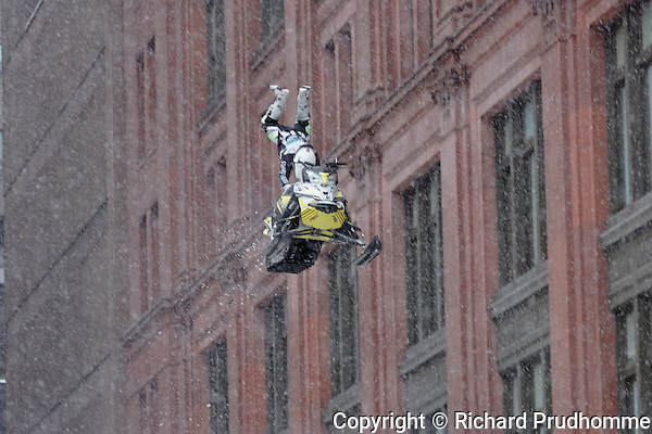 World snowmobiling champions perform aerial tricks in downtown Montreal.