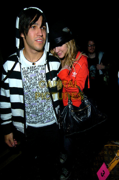 PETE WENTZ (FALL OUT BOY) & ASHLEE SIMPSON.The Fall Out Boy afterparty, Chinawhites bar & nightclub, London, England..August 22nd, 2007.full length hoodie hoody hooded top adidas red top black bag purse red white striped stripes couple converse trainers sneakers .CAP/CAN.©Can Nguyen/Capital Pictures