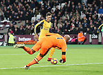 Arsenal's Mesut Ozil scoring his sides opening goal during the Premier League match at the London Stadium, London. Picture date December 3rd, 2016 Pic David Klein/Sportimage